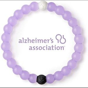NWOT cleat purple Alzheimer's lokai - medium